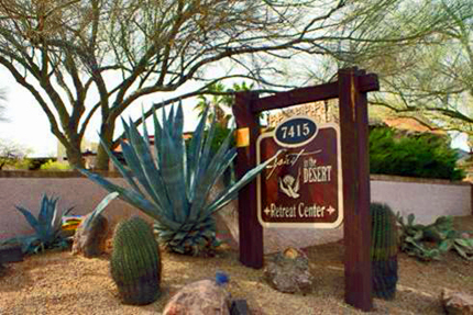 entrance sign at spirit in the desert