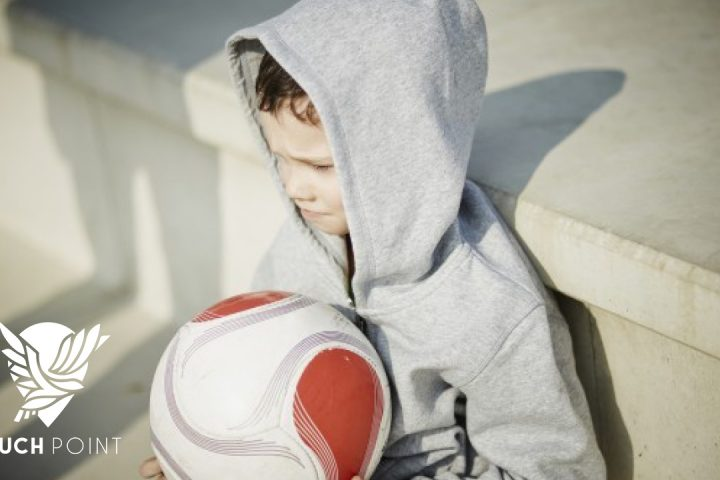 """Dejected child with ball illustrates Wednesday Respite Touchpoint 'Just KIDding"""""""