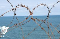 Barbed wire fence in the shape of a heart illustrates Bro. Jim's Touchpoint